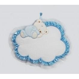 Teddy bear sleeping on a cloud